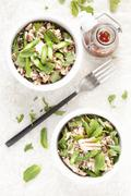 Wild rice salad with salmon, green asparagus and herbs (seen from above) Stock Photos
