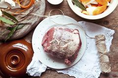 Beef brisket with vegetables and herbs ready to roast Stock Photos