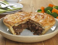Steak and onion pie, sliced Stock Photos