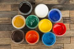 Jars with a colorful paint gouache. Stock Photos