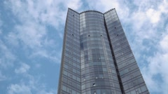 Modern business building on a background of the blue sky. Copy space text Stock Footage