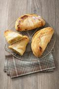 Apple turnovers on a wire rack Stock Photos