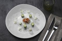 Caviar with champagne foam and mini courgettes Stock Photos