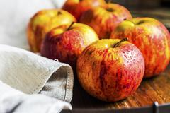 Fresh apples on a wooden surface Stock Photos