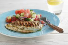 Grilled chicken breast with a watermelon and cucumber salad Stock Photos