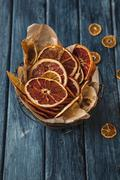 Dried orange slices in a wire basket Stock Photos