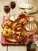 An arrangement of various tapas on a serving board Stock Photos