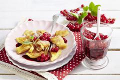 Shredded pancakes with redcurrant compote Stock Photos