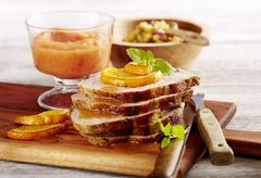 Roast Florida pork with a mango and pineapple salsa and sweet potato crisps Stock Photos
