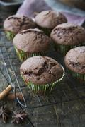 Chocolate muffins with cinnamon and star anise Stock Photos