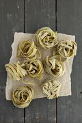 Spinach tagliatelle on a dark grey wooden table Stock Photos