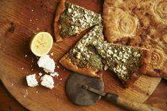 Unleavened bread with goats cheese and pesto with Afghan bread Kuvituskuvat