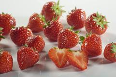 Fresh strawberries, whole and halved Stock Photos