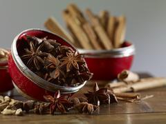 Star anise, cinnamon sticks and cardamom Stock Photos