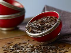Wild rice in a red bowl Stock Photos