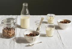 A breakfast table laid with muesli and milk Stock Photos