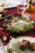 Celeriac and potato salad with ham and lambs lettuce Stock Photos