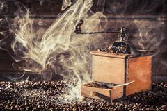 Freshly ground coffee and an old coffee grinder Stock Photos