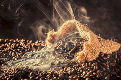 Aromatic coffee in an old sack Stock Photos