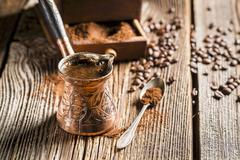 Turkish mocha in a copper jug Stock Photos