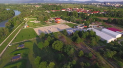 AERIAL: Flying above equine center, big river and recreational park area Stock Footage
