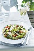 A mixed green salad with pine nuts, olives and fenugreek cheese Stock Photos