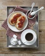 Cup of coffee and bread and jam on a breakfast tray (seen from above) Stock Photos
