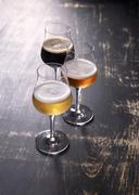 Three types of beer in glasses Stock Photos