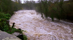 HEAVY FLOOD WATER AYSGARTH FALLS NORTH YORKSHIRE Stock Footage