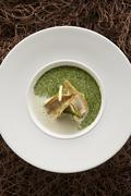 Foamy watercress soup with fried Lake Constance whitefish fillets and asparagus Stock Photos