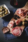 An open salami sandwich and an open ham and cheese sandwich on a supper board Stock Photos