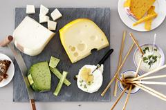 A cheese platter with breadsticks Stock Photos