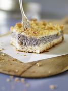 A slice of poppyseed cake Stock Photos
