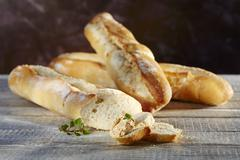 French wheat baguettes with a dip and oregano Stock Photos