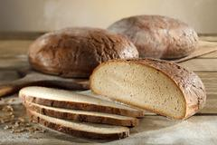 Three loaves of country bread (wheat and rye) with rye grains Stock Photos