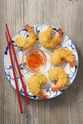 Breaded prawns with a sweet chilli sauce Stock Photos