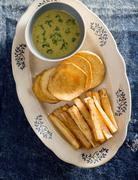 Fried cassava and sweet potatoes with a dip (Caribbean) Stock Photos