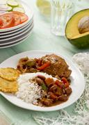 Braised chicken with beans, rice and tostones (Dominican Republic) Kuvituskuvat