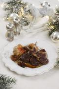 Lamb chops with apples and spices for Christmas Stock Photos
