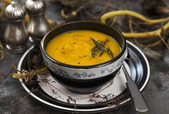 Cream of pumpkin soup with sage Stock Photos