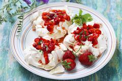 Meringue with strawberries Stock Photos