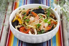 Spaghetti with seafood and peppers Stock Photos