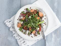 Salmon salad with lentils and rocket Stock Photos