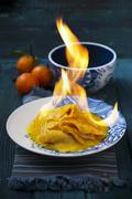 Crêpe Suzette being flambéed with orange syrup and orange liqueur Stock Photos
