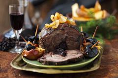 Roast wild boar with a plum stuffing Stock Photos