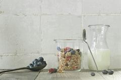 Muesli with fresh blueberries and dried raspberries Stock Photos