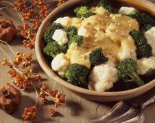 Cauliflower and broccoli with cheese sauce Stock Photos