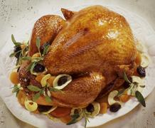 Festive roast turkey with dried fruits and sage Stock Photos
