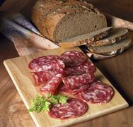 Supper with dark bread and salchichon Stock Photos
