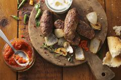 Cevapcici with ajvar (grilled minced meat sausages, Balkans) Stock Photos